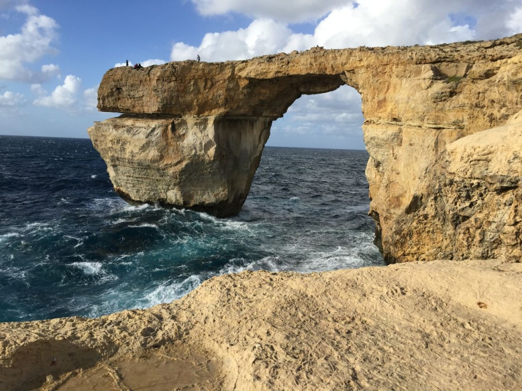 i was standing at the edge of this cliff wondering if i would jump it happened at the azure window the blue window which is on the island of gozo